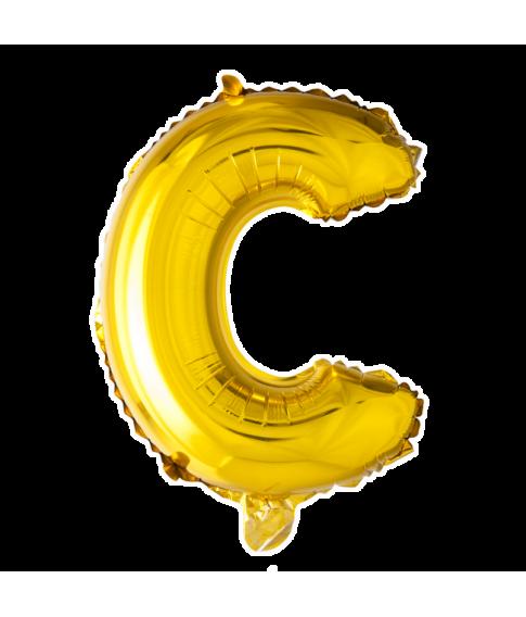 Guld folie bogstav ballon med bogstavet C.