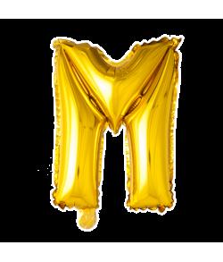 Guld folie bogstav ballon med bogstavet M.
