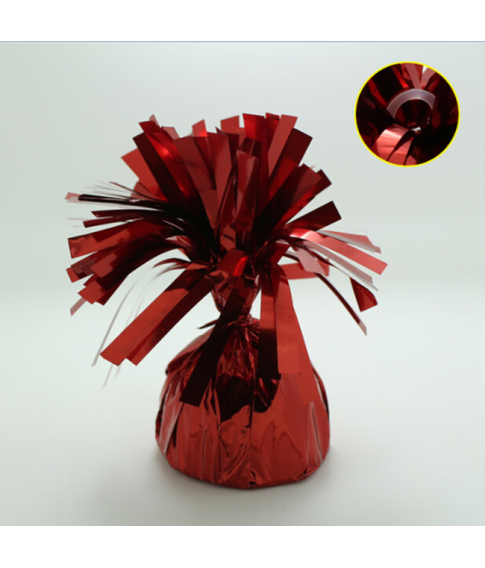 Rød ballonvægt med øje pakket ind i folie.