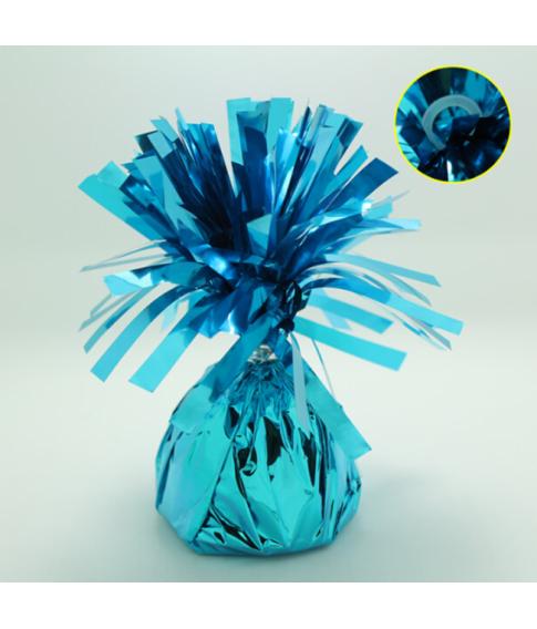 Lys blå ballonvægt med øje pakket ind i folie.