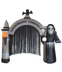 Uhyggelig oppustelig indgang til kirkegård med døden med le stående.