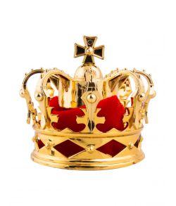 Lille guld krone med hårklips og rødt filt.