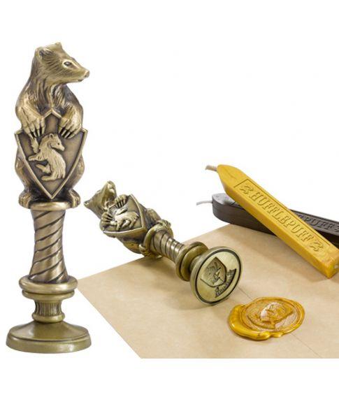Hufflepuff vokssegl i metal med voks fra Noble Collection.
